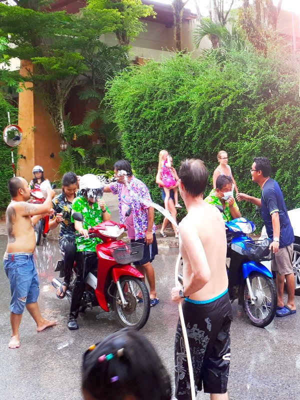 Water fights offer a chance to cool off in the hot Khao Lak weather.