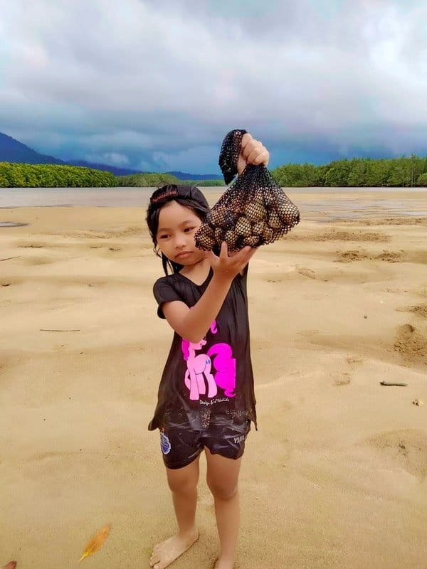 Child with a bag of clams